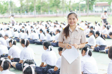 Thai teachers in official uniform on morning duty Stock fotó
