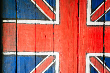 britain: United kingdom flag painted on wooden window Stock Photo