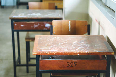 antique sleigh: Wooden Thai school desk and chairs Stock Photo