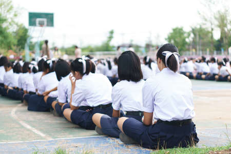 to announce: Thai students sit on the floor for school morning announce