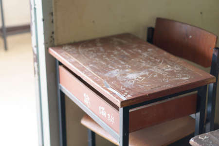 poverty: Wooden Thai school desk and chairs Stock Photo