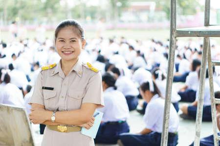 Thai teachers in official uniform on morning duty Stock Photo