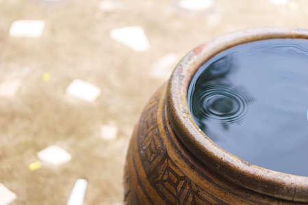 Thai traditional jar with rain water