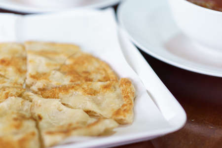 paratha: Sliced round Roti, indian food made with flour