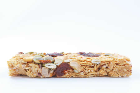 cereal bar: Healthy cereal bar with fruits on white background