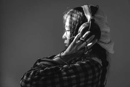 charming girl: Charming Asian girl with earphones