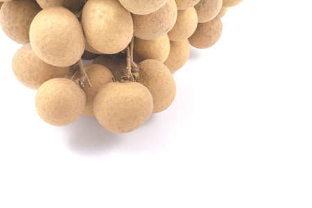 flesh colour: Longan Asian fruit on white background