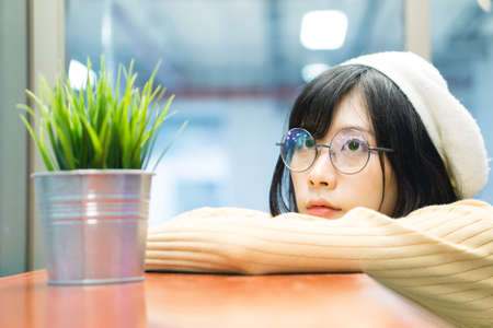 Charming Asian girl with a green plant pot