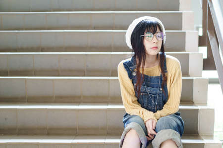 bib overall: Charming Asian girl wearing jean overalls