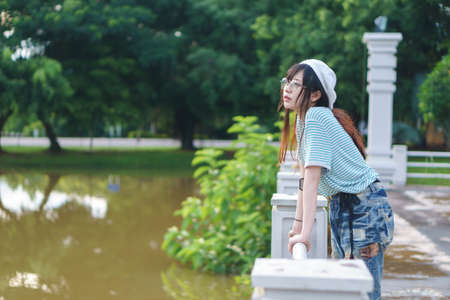 Charming Asian girl wearing jean overalls