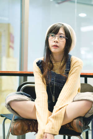 Charming Asian girl sit in cafe Stock Photo