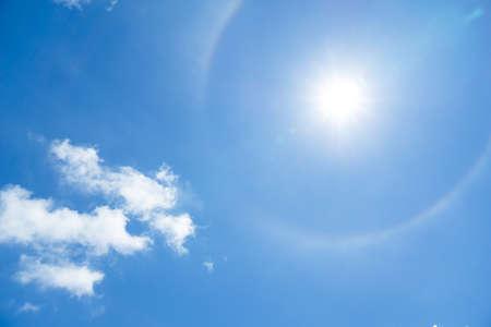 青空に太陽のハロー現象 写真素材