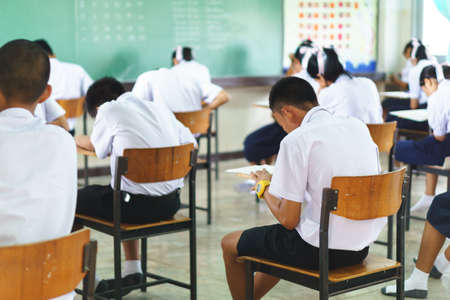 schoolroom: Group of Asian students in classroom