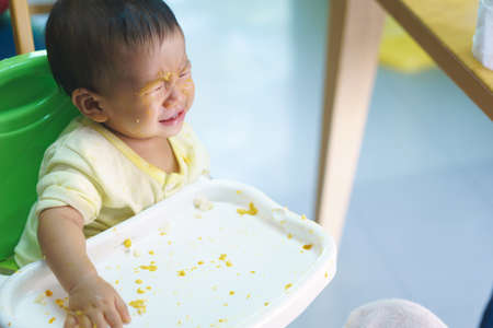 9 months old: 9 months old Asian baby refuses eating medicine after meal Stock Photo