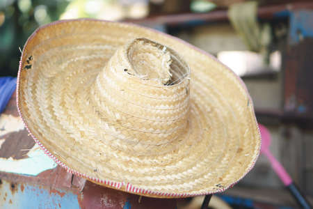 holey: Worn And Holey Straw Hat