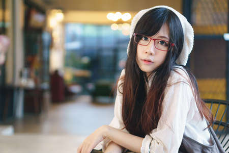 charming girl: Portrait of charming Asian girl in a coffee shop