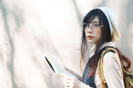 casual wear: Charming Asian girl in casual wear at university