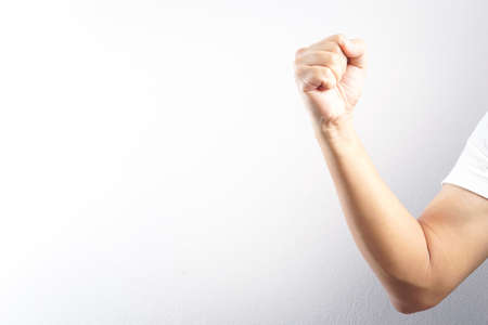 Man clenched fist on white background Stock Photo