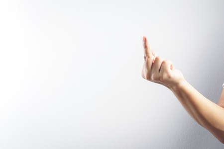A hand gesture using for word as fuck you Фото со стока