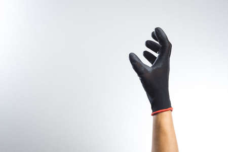 A hand wearing black glove with action gesture