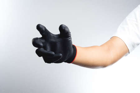 gloved: A hand wearing black glove with action gesture