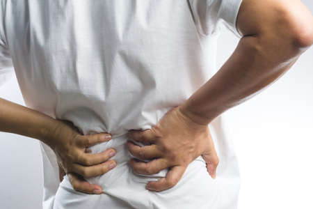 A man with back pain on white background