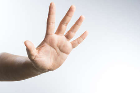 hand with stop gesture on white background Stock Photo
