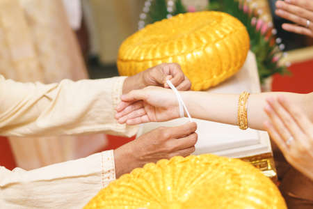 rite: Northern Thai wedding ceremony by tie hand wrist with holy thread Stock Photo