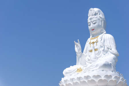 White Statue of The Guanyin, The Goddess of Compassion and Mercy in China culture locate in public temple of Northern Thailand Editorial