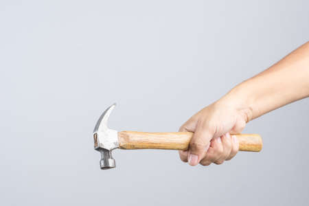 claw hammer: Hand holding custom wooden grip hammer on white background Editorial