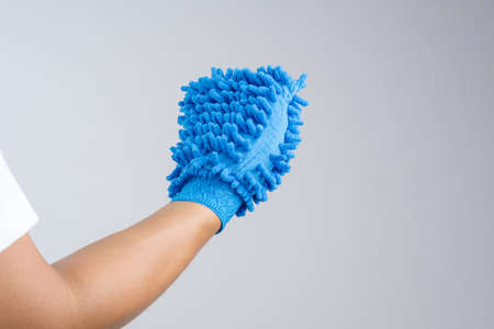 microfiber: Hand wearing dust glove or double sided mitt microfiber car wash on white background Stock Photo