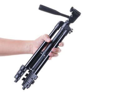 Hand holding a tripod, a photography stabilize and elevate equipment for taking a photo or video on white background Stock Photo