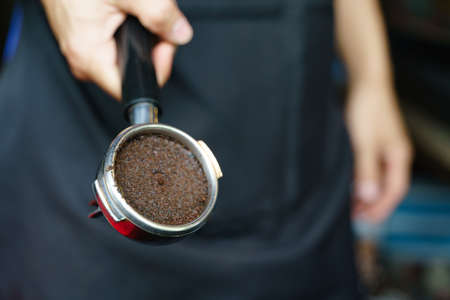Used coffee grounds from espresso machine Banco de Imagens