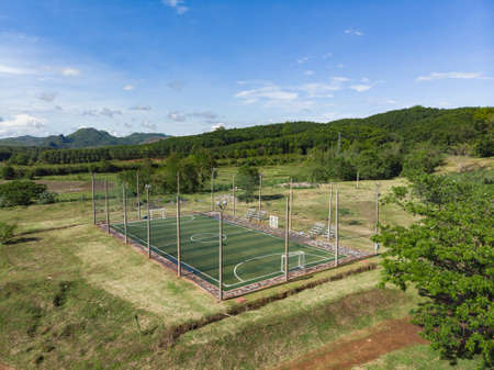 Outdoor futsal, soccer court with players at both team in public university 版權商用圖片
