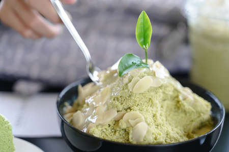 Matcha, japanese green tea shaved ice creamy sweet dish or bingsu