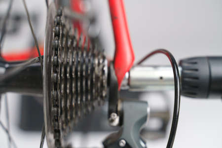 Bike cassette with chain and gear shift mechanism running on cycling trainer