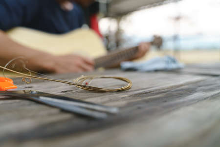 Changing acoustic guitar string chord