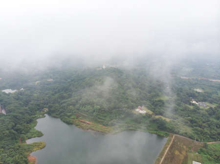 Morning cloud fog or mist over Thai public temple in the forest hill mountain of Asian countryside 版權商用圖片