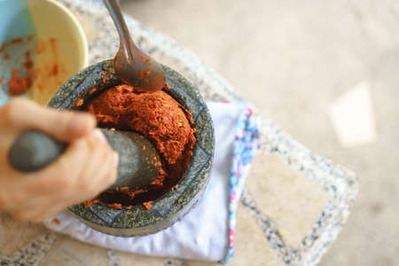 Thai chili traditional food cooking style by grinding in stone mortar with pestle