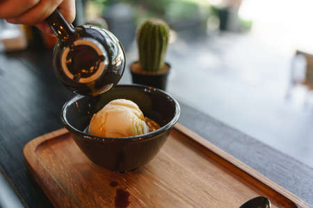 Affogato or vanilla gelato ice cream scoop serving with espresso black coffee