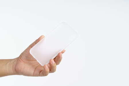Hand holding modern silicone or rubber phone case on white background