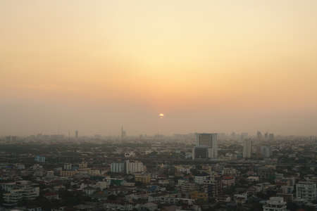 Sunset at Bangkok, capital of Thailand with dust and smoke from air pollution problem