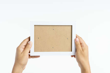 Hand holding blank picture wooden frame on white background 版權商用圖片