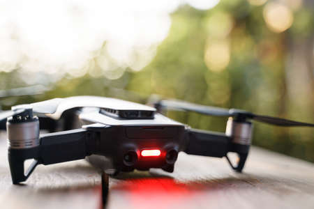 Modern small quad copter drone with digital camera with red light refer to problem and can not take off Archivio Fotografico