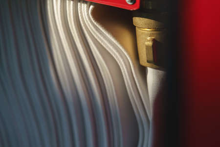 Brass fire hose reel in the cabinet