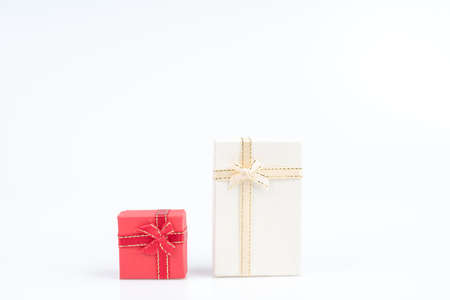Small gift box with ribbon and bow for special occasion on white background
