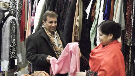 Asian business woman selling to a customer