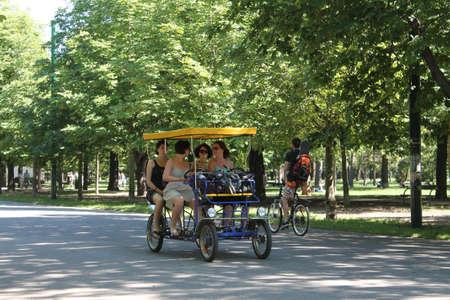 Friends riding in a rickshaw in Vienna, Austria Editorial