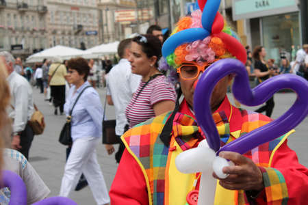 Clown with a colourful coat