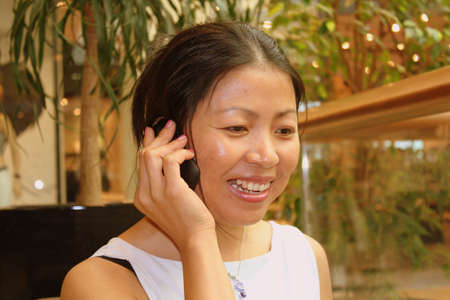 Asian Business Woman talking on her mobile Stock Photo